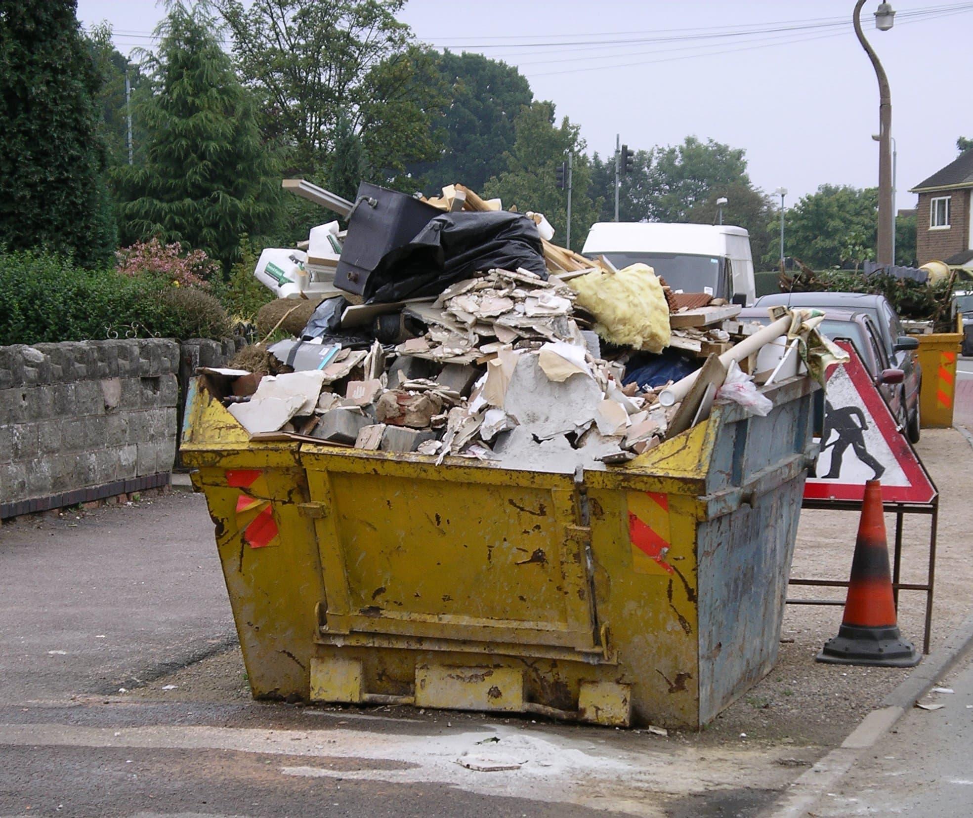 yellow skip containing rubbish