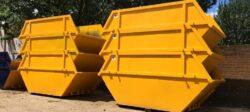 stacked yellow skips skip hire
