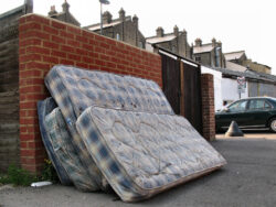 mattresses leaning on eachother outside kerbside