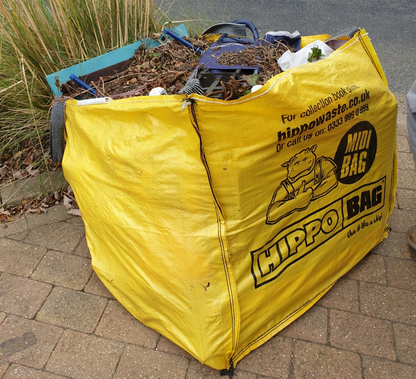 skip bag full of trade diy waste waiting for collection and disposal